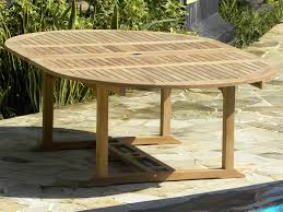 fixed teak tables and extending garden tables