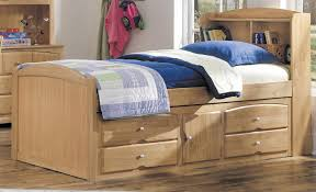 solid wood twin captain bed with storage drawers and single door