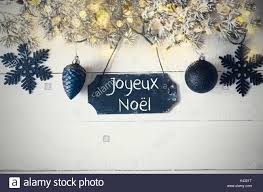 plate light joyeux noel means merry stock photo