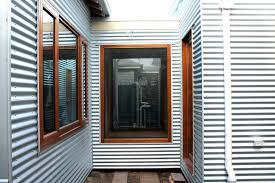 Home Decor Shopping Catalogs Interior Wonderful Black Glass Corner Window With Birch Wood