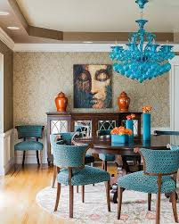 dining room dark blue painted wall with blue pattern fabric