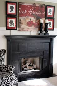 large size mantel decorating idea above black fireplace matched