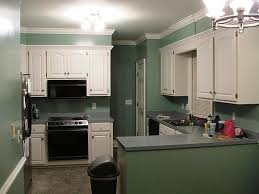 amazing do it yourself painting kitchen cabinets 634x422