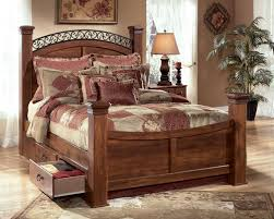 king poster bed with underbed storage by signature design by