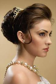 poof at the crown hairstyle simple hair buns for saree