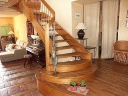 modern curved stair in elm built using horizontal laminates