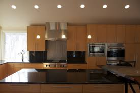 interior led recessed lights with cream marble countertop