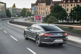 volkswagen arteon r line 2019 volkswagen arteon r line rear three quarter in motion 03 1