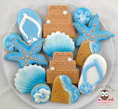 seashell shaped cookies wedding cookies by whoos bakery brown sand castle white