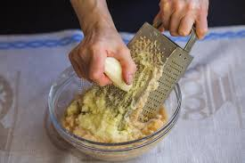 potato pancake grater potatoes shredded on a grater stock photo image of meat