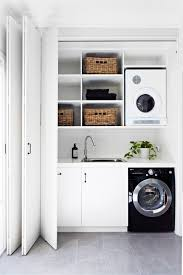 How To Clean Kitchen Cabinet Doors Downsize Your Laundry Slotting Your Washing Machine And Dryer