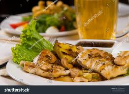 Main Dish With Sauce - close gourmet juicy chicken meat main stock photo 222383614