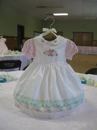 Hangers For Baby Clothes Use A Baby Dress As The Centerpiece For A Baby Shower Baba