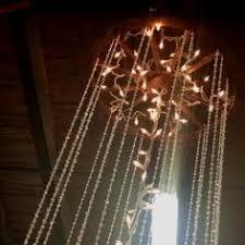 Diy Wagon Wheel Chandelier Wagon Wheel Chandelier With Mason Jars For Wedding First Then