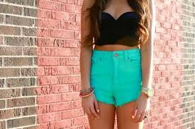 wear low rise jeans and avoid high waisted shorts or jeans