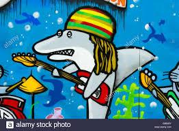 graffiti mural guitar stock photos graffiti mural guitar stock graffiti on wall i norrebro copenhagen shark playing guitar multicolored cap blue