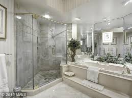traditional master bathroom with high ceiling u0026 handheld shower