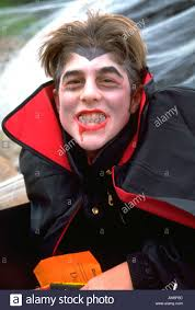 boy age 16 in dracula costume at anoka halloween festival anoka