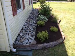 use rocks or seashells next to foundation to prevent bugs mud