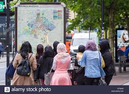 Map Of Manchester England by A Group Of Young Women Viewing The Map Of Manchester City Centre