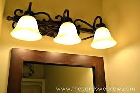 Replacing Bathroom Light Fixture How To Remove A Bathroom Light Fixture And How To Install A