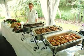 decorative use of chafing dishes on a buffet table set up lovely
