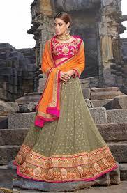 green designer punjabi wedding lehenga with contrast pink choli