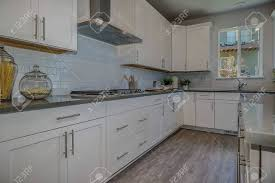 maple kitchen cabinets with white granite countertops chef s kitchen with white maple cabinets and granite countertops