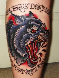 colored angry wolf on leg