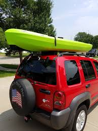 jeep with surfboard kayak lift assist suction mounted roof roller storeyourboard com