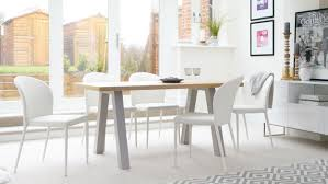 6 seater oak dining table 6 seater oak dining table and stackable dining chairs from the julia