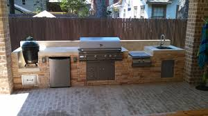 This Outdoor Kitchen By Outdoor Homescapes Of Houston Features - Outdoor bbq kitchen cabinets