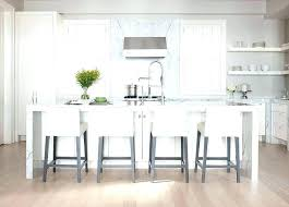 white kitchen island with stainless steel top white kitchen island white slab kitchen cabinets white