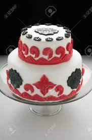 double tiered cake with white red and black fondant decorations
