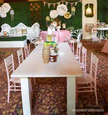 028 mini whitewash farmhouse tables u0026 pink chiavari chairs behind