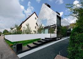 german home gets modern revamp with reflective paneled funhouse
