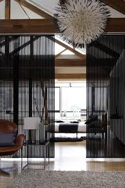 vertical blinds make great room dividers in either a modern or