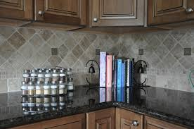 grey slate backsplash with ubatuba black granite countertops