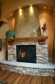 raised hearth fireplace ideas stacked stone wall color surround