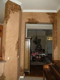 Interior Stucco Wall Designs by Wallpaper Designer Tuscan Tan Stucco Wall With Red Exposed Brick