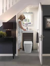 compact bathroom under stairs with simple design in compact