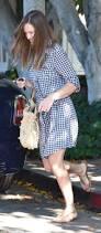 hilary swank works daytime glamour in chic gingham shirt dress