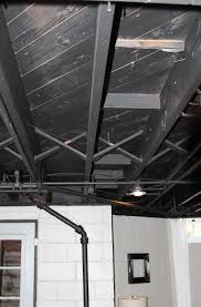 exposed basement ceiling painted black home design ideas