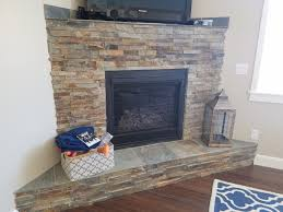 california gold ledger stone accent wall and fireplace surround
