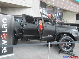 toyota tundra pickup lifted with crude fender flares carbon