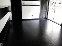 imposing design of painted hardwood floors in black paint color