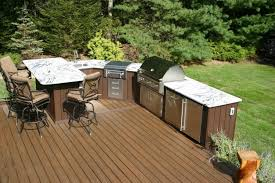25 modern kitchens in wooden finish digsdigs cool dark finished wooden deck and chic outdoor kitchen ideas for