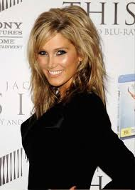 pictures of delta goodrem layered medium hairstyle with bangs