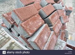 haphazard pile of new clean construction bricks in a haphazard disordered