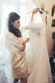 wedding dressing gowns tries on a wedding dress dressing gown happy beautiful